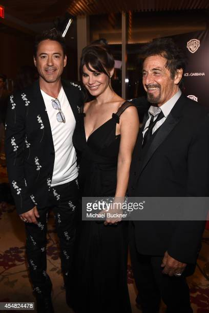 Actor Robert Downey Jr Lucila Sola and actor Al Pacino attend the Warner Bros Pictures and Dolce Gabbana TIFF cocktail party during the 2014 Toronto...
