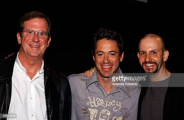Actor Robert Downey Jr poses with director Keith Gordon and film historian Pete Hammond attend the Variety screening of The Singing Detective at The...