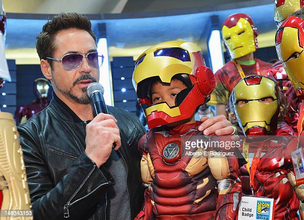 Actor Robert Downey Jr poses with fans at Marvel Studios booth during ComicCon International 2012 at San Diego Convention Center on July 14 2012 in...