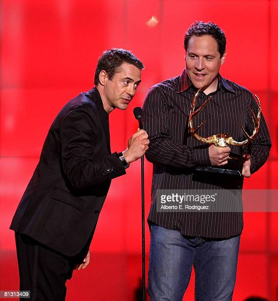 Actor Robert Downey Jr presents the Guy Movie of the Year award to actor/director Jon Favreau onstage during the taping of Spike TV's 2nd Annual Guys...