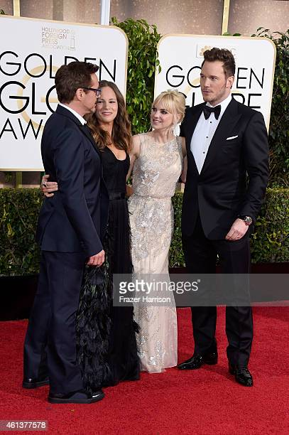Actor Robert Downey Jr producer Susan Downey actress Anna Faris and actor Chris Pratt attend the 72nd Annual Golden Globe Awards at The Beverly...