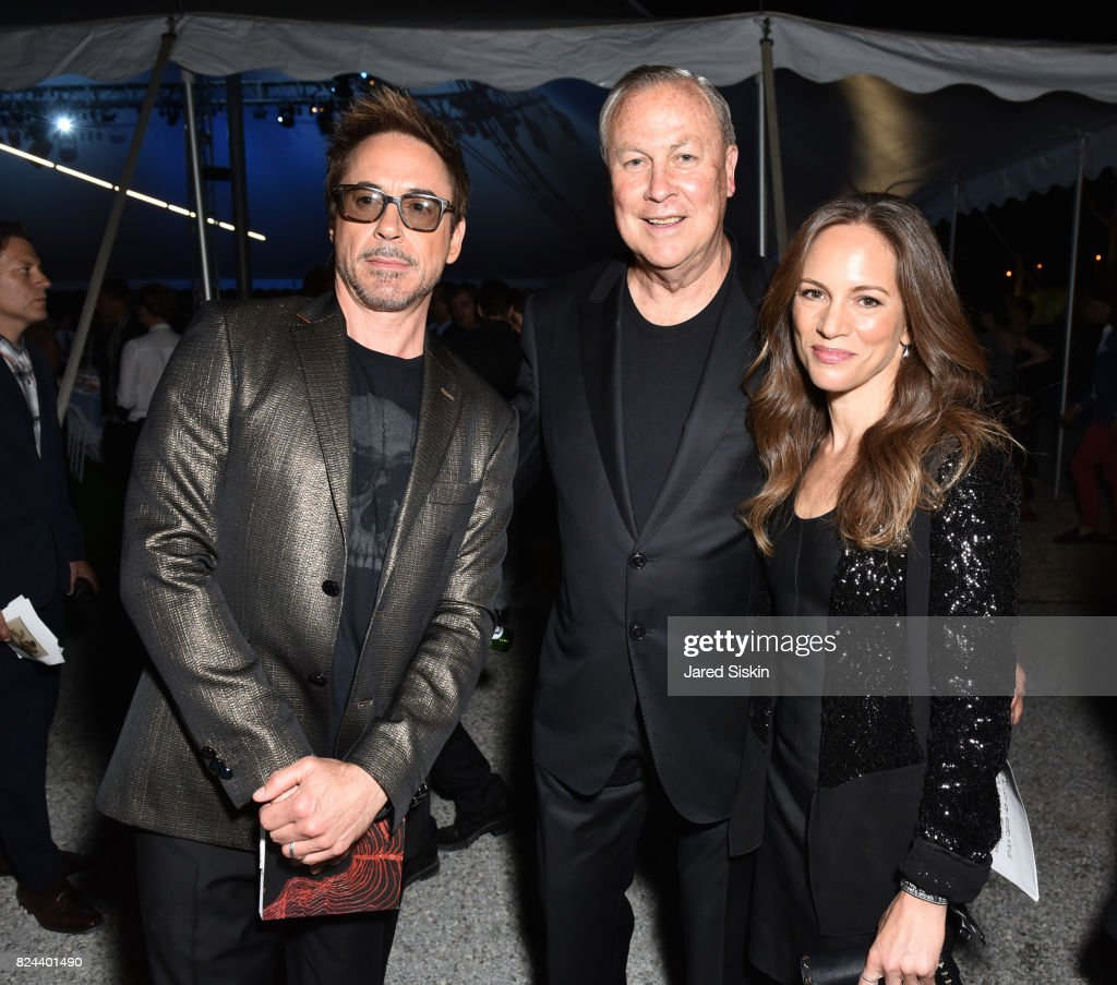 Actor Robert Downey Jr., Robert Wilson and Susan Nicole Downey attend The 24th Annual Watermill Center Summer Benefit & Auction at The Watermill Center on July 29, 2017 in Water Mill, New York.