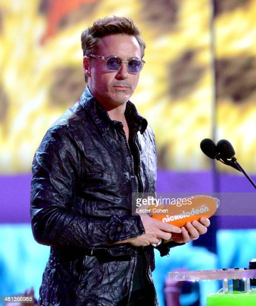 Actor Robert Downey Jr speaks onstage during Nickelodeon's 27th Annual Kids' Choice Awards held at USC Galen Center on March 29 2014 in Los Angeles...