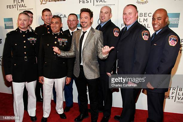 Actor Robert Downey Jr with US Military officers and NYC Firemen attend Marvel's The Avengers premiere during the closing night of the 2012 Tribeca...