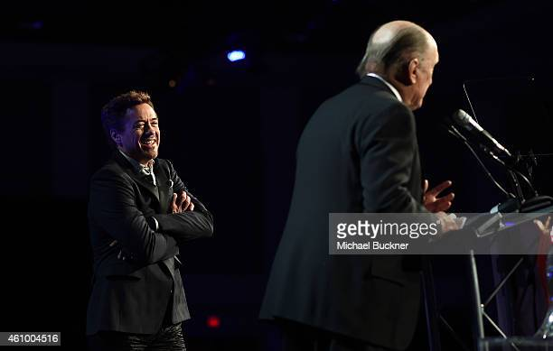 Actor Robert Duvall accepts the Icon Award from actor Robert Downey Jr onstage during the 26th Annual Palm Springs International Film Festival Awards...