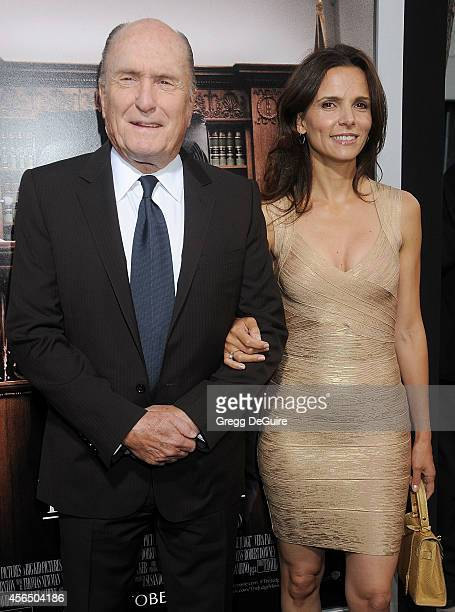 Actor Robert Duvall and wife Luciana Pedraza arrive at the Los Angeles premiere of The Judge at AMPAS Samuel Goldwyn Theater on October 1 2014 in...