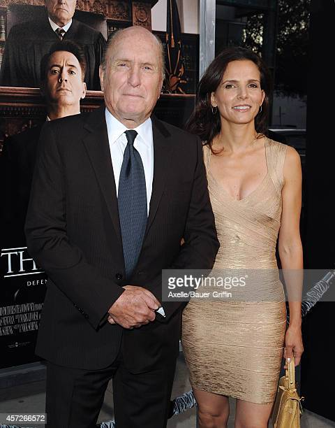 Actor Robert Duvall and wife Luciana Pedraza arrive at the Los Angeles Premiere of 'The Judge' at AMPAS Samuel Goldwyn Theater on October 1 2014 in...