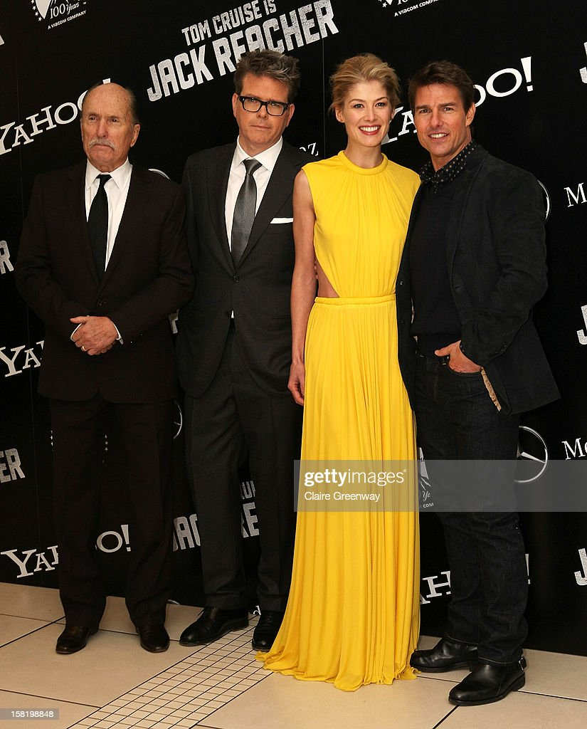 Actor Robert Duvall, director Christopher McQuarrie and actors Rosamund Pike and Tom Cruise attend the world premiere of 'Jack Reacher' at The Odeon Leicester Square on December 10, 2012 in London, England.