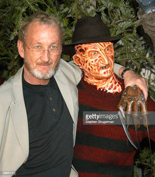 Actor Robert Englund poses with Freddy wax figure at the Hollywood Wax Mueum for the debut of the DVD release of Freddy Vs Jason on January 13 2004...