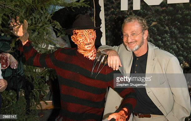 Actor Robert Englund poses with Freddy wax figure at the Hollywood Wax Mueum for the debut of the DVD release of 'Freddy Vs Jason' on January 13 2004...