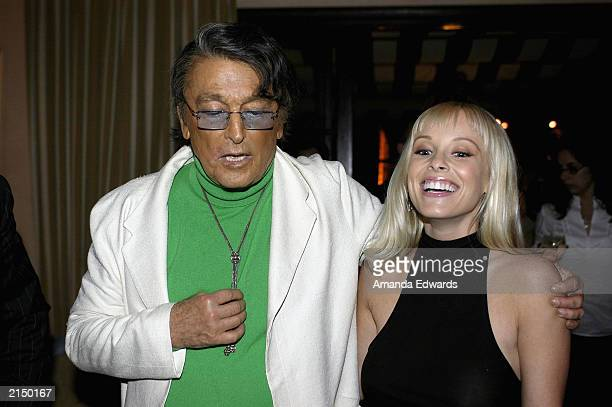 Actor Robert Evans chats with actress Jaime Bergman at Comedy Central's celebration of Evans' upcoming animated series 'Kid Notorious' on July 9 2003...