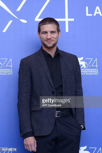 Actor Robert Finster attends the photocall of the movie Krieg presented in the Orizzonti selection at the 74th Venice Film Festival on September 8...