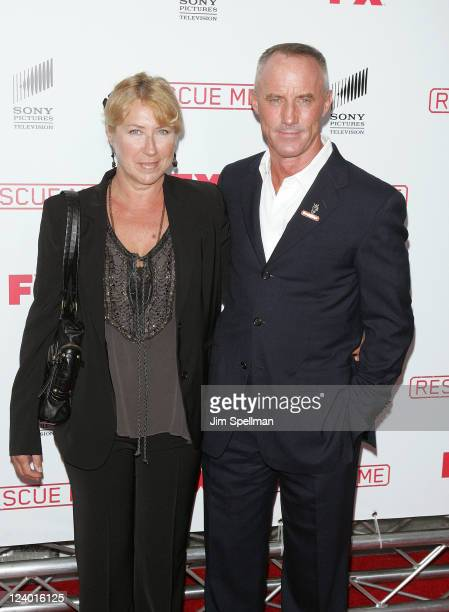 Actor Robert John Burke and wife attend the Rescue Me Season 7 series finale episode screening at the Ziegfeld Theatre on September 7 2011 in New...