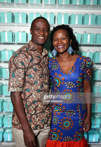 Actor Robert Katende and Sarah Katende attend the Vanity Fair and Tiffany Co private dinner toasting Lupita Nyong'o and celebrating Legendary Style...