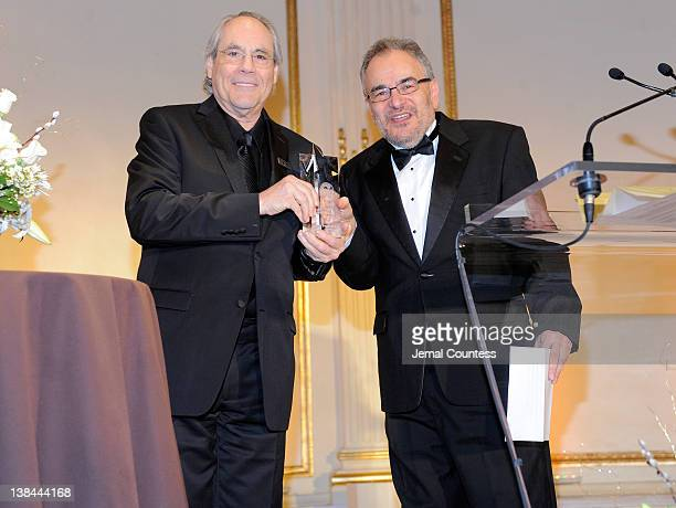 Actor Robert Klein and winner of the 2012 AMEE Award in Broadcast, Pete Fornatale onstage at the AFTRA Foundation's 2012 AFTRA Media and...
