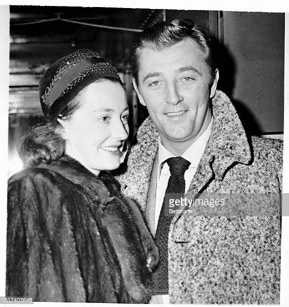 Actor Robert Mitchum and his wife Dorothy arrive at Grand Central Station Nov 21 for the premier of his first picture since his release from jail...