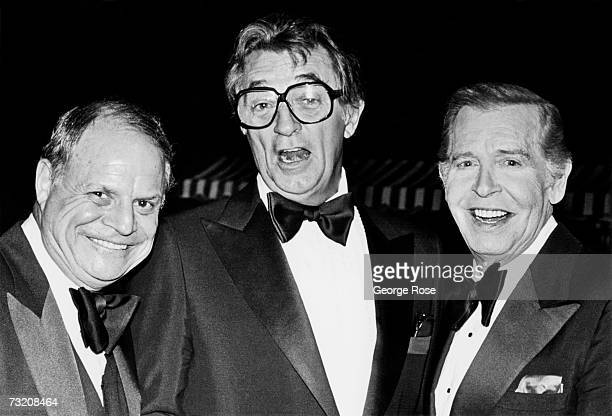 Actor Robert Mitchum is flanked by comedians Don Rickles and Milton Berle while attending a 1979 Las Vegas Nevada awards ceremony honoring Frank...