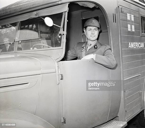 Actor Robert Montgomery sits behind the wheel of an ambulance in Paris on June 6 1940 He drives the American Field Service vehicle before reporting...