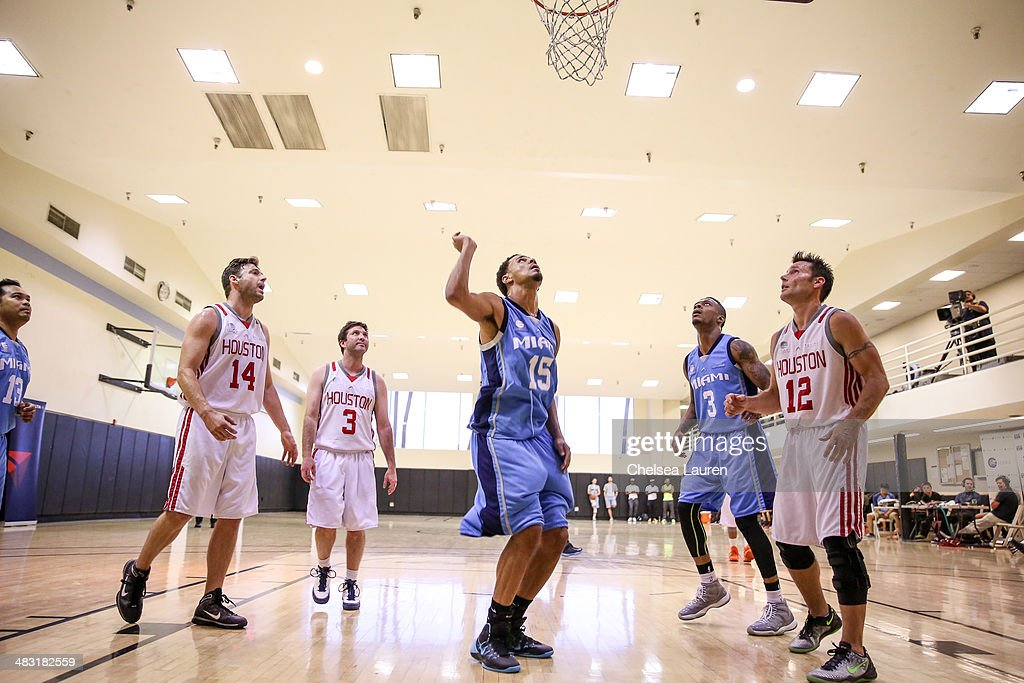 Actor Robert Parks-Valletta, agent Harold Augenstein, recording artist J. Cole, rapper Kosine and actor Don Money attend the E-League celebrity basketball game at Equinox Sports Club West LA on April 6, 2014 in Los Angeles, California.