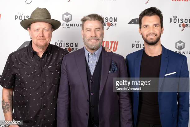 Actor Robert Patrick actor John Travolta and producer Andrea Iervolino attend Ambi Tatatu Gala Honouring 'The Poison Rose' on July 15 2018 in...