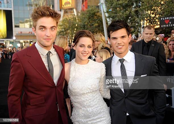 "Actor Robert Pattinson, actress Kristen Stewart and actor Taylor Lautner arrive at the premiere of Summit Entertainment's ""The Twilight Saga:..."