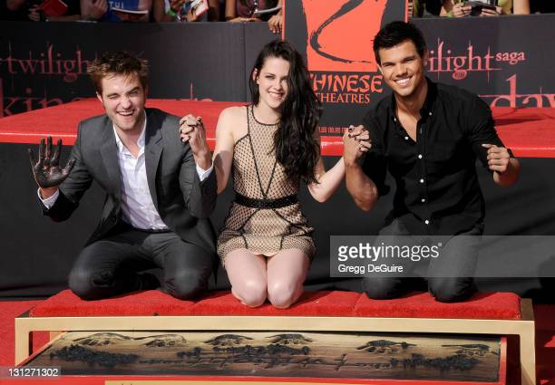 """Actor Robert Pattinson, actress Kristen Stewart and actor Taylor Lautner at """"The Twilight Trio"""" Hand/Footprint Ceremony at Grauman's Chinese Theatre..."""