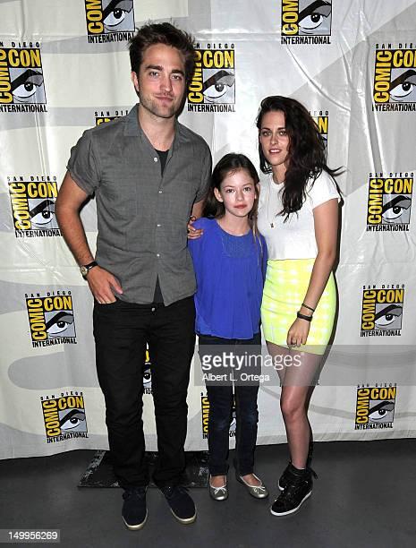 Actor Robert Pattinson actress Mackenzie Foy and actress Kristen Stewart participate in The Twilight Saga Breaking Dawn Part 2 Panel ComicCon...