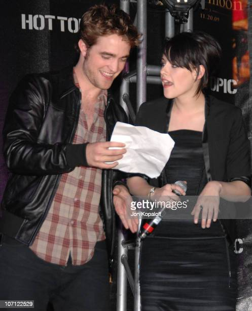 Actor Robert Pattinson and actress Kristen Stewart speak at 'The Twilight Saga New Moon' Cast Tour at Hot Topic on November 6 2009 in Hollywood...