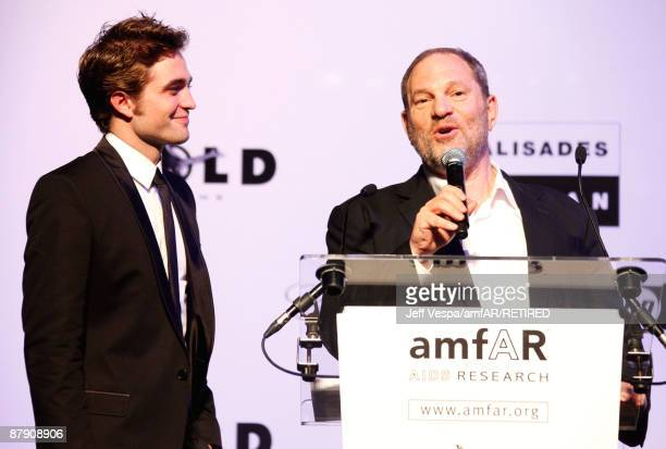 Actor Robert Pattinson and producer Harvey Weinstein onstage during amfAR's Cinema Against AIDS 2009 benefit at the Hotel du Cap during the 62nd...