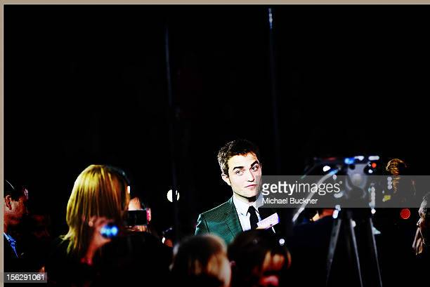 Actor Robert Pattinson arrives at the Summit Entertainment's The Twilight Saga Breaking Dawn Part 2 at Nokia Theatre LA Live on November 12 2012 in...