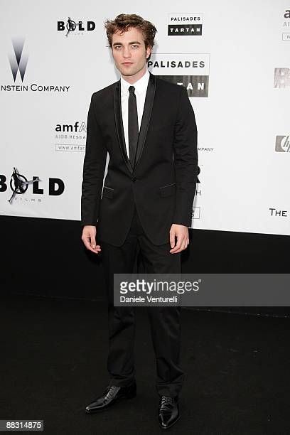 Actor Robert Pattinson attends the amfAR Cinema Against AIDS 2009 benefit at the Hotel du Cap during the 62nd Annual Cannes Film Festival on May 21...