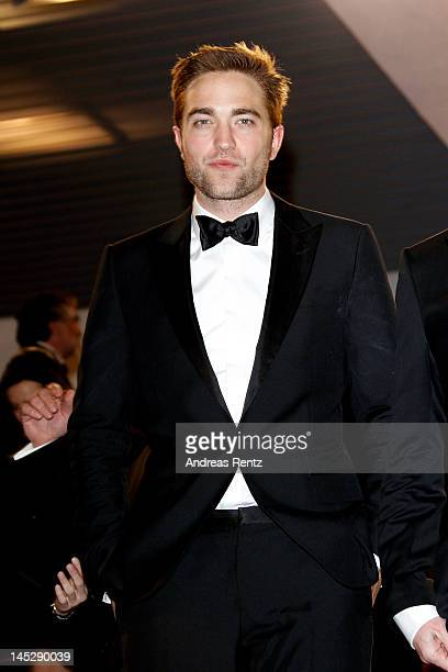Actor Robert Pattinson departs the 'Cosmopolis' premiere during the 65th Annual Cannes Film Festival at Palais des Festivals on May 25 2012 in Cannes...