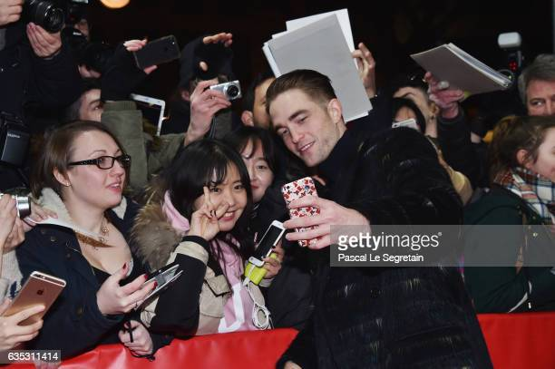 Actor Robert Pattinson is taking a selfie with fans at the 'The Lost City of Z' premiere during the 67th Berlinale International Film Festival Berlin...