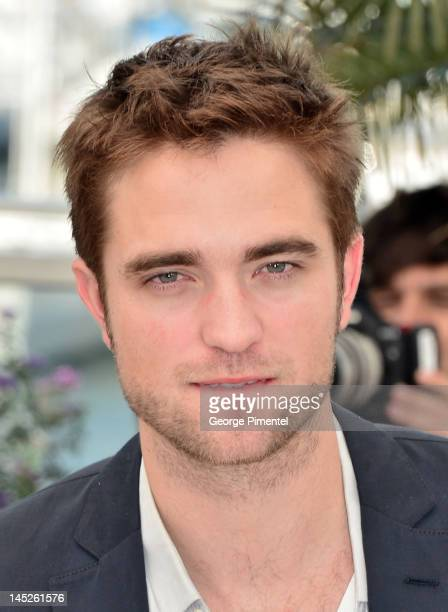 Actor Robert Pattinson poses at the 'Cosmopolis' photocall during the 65th Annual Cannes Film Festival at Palais des Festivals on May 25 2012 in...