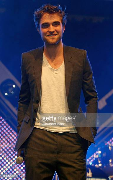 Actor Robert Pattinson smiles as he presents his new film 'The Twighlight New Moon' during the HVB youth event at the Olympic Hall on November 14...