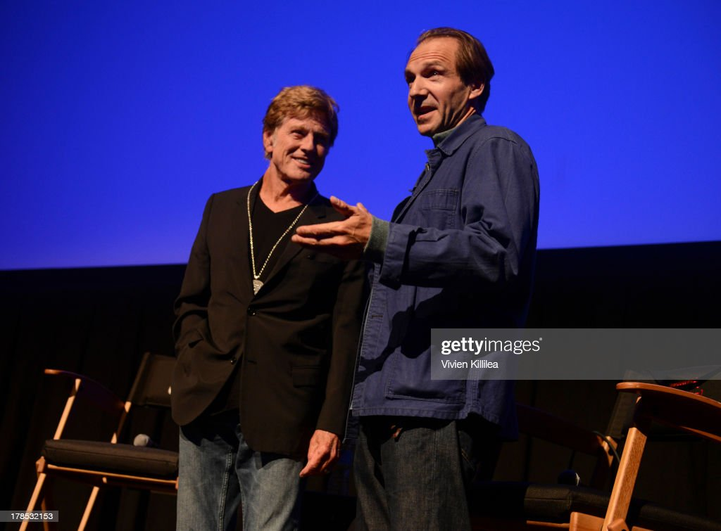 Actor Robert Redford accepts his tribute award from actor Ralph Fiennes on day 1 of the 2013 Telluride Film Festival on August 29, 2013 in Telluride, Colorado.