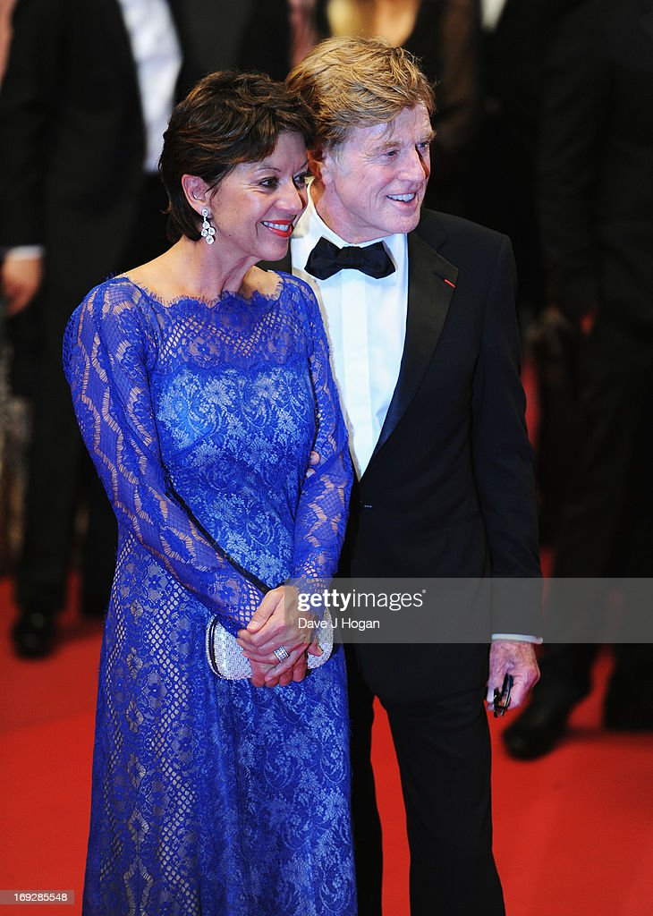 Actor Robert Redford (R) and his wife Sibylle Szaggars leave the 'All Is Lost' Premiere during the 66th Annual Cannes Film Festival at Palais des Festivals on May 22, 2013 in Cannes, France.