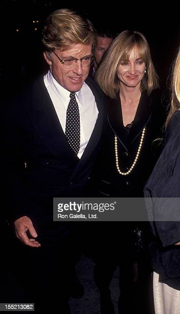 Actor Robert Redford and Kathy O'Rear attend the premiere of A River Runs Through It on October 8 1992 at the Ziegfeld Theater in New York City