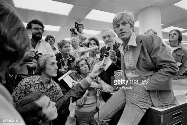 Actor Robert Redford gives a press conference on the set of Alan J Pakula's film All the President's Men