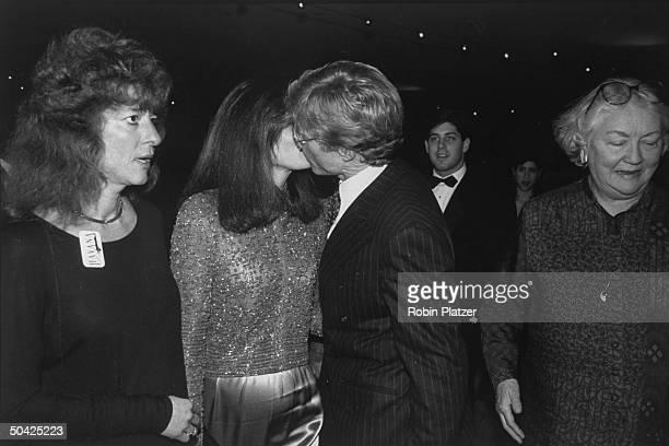 Actor Robert Redford kissing his costar Lena Olin goodbye at premiere of Havana