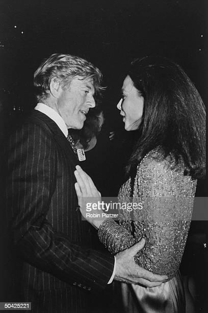 Actor Robert Redford w costar Lena Olin at premiere of Havana