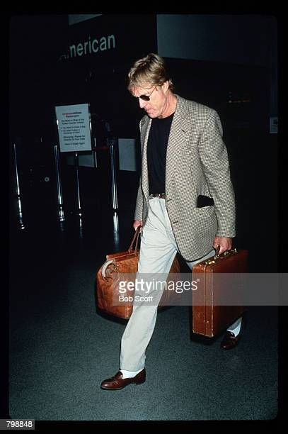 Actor Robert Redford walks April 1994 though the LAX International Airport in Los Angeles California