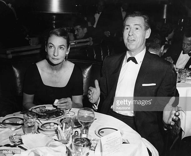 Actor Robert Ryan and his wife Jessica sitting at their dinner table during an event in Hollywood CA circa 1950