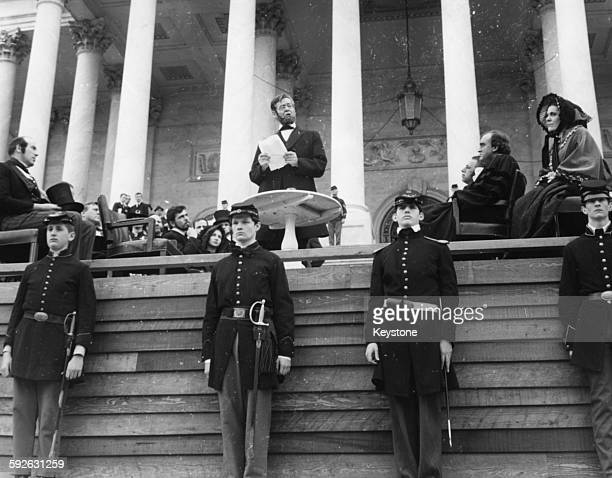 Actor Robert Ryan in character as former US President Abraham Lincoln delivering his address surrounded by Civil Warera soldiers marking the 100th...