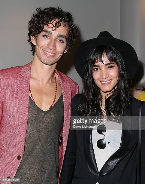"""Actor Robert Sheehan and dancer Sofia Boutella attend the 2014 Los Angeles Film Festival screening of """"The Road Within"""" at Regal Cinemas L.A. Live on..."""
