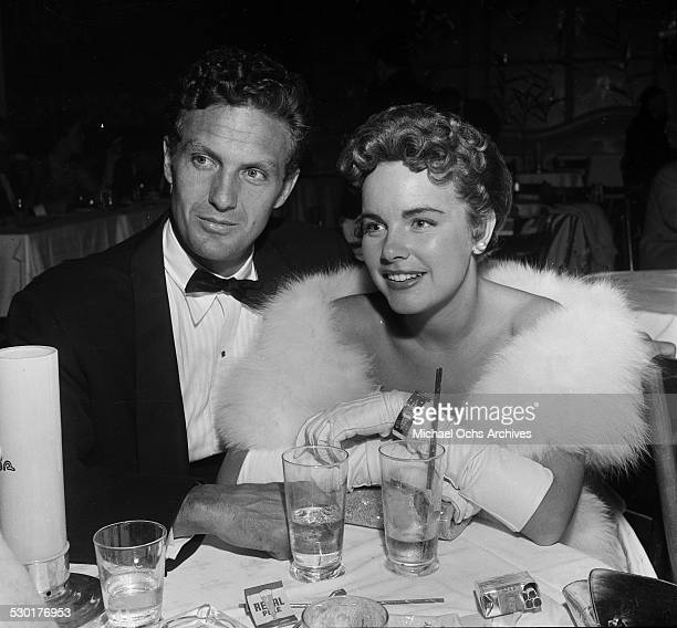 Actor Robert Stack and Terry Moore attend the premiere dinner party for High and Mighty in Los AngelesCA