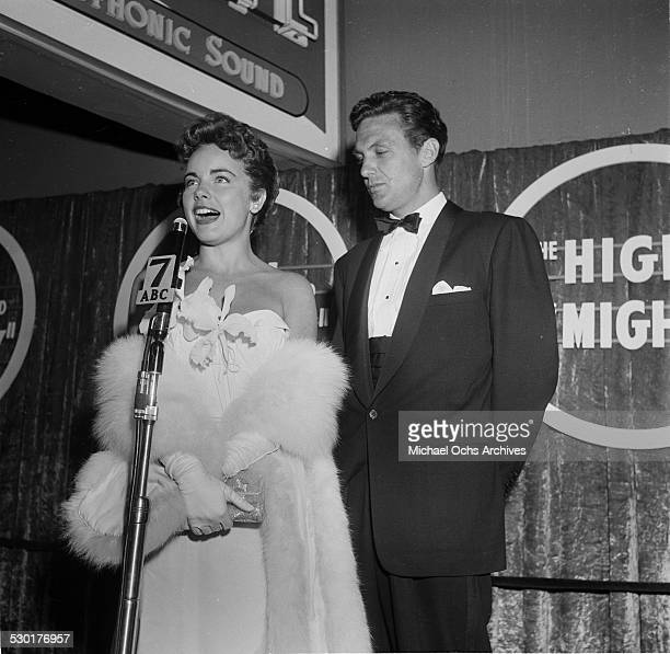 Actor Robert Stack and Terry Moore attend the premiere for High and Mighty in Los AngelesCA