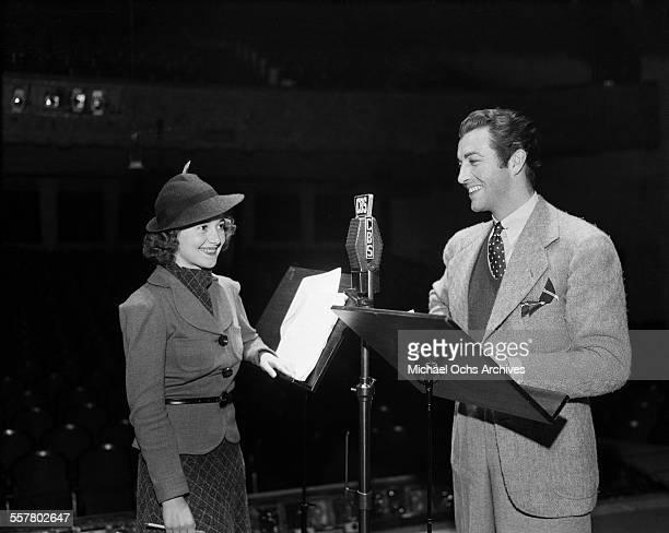 Actor Robert Taylor and actress Olivia de Havilland at CBS radio station in Los Angeles California