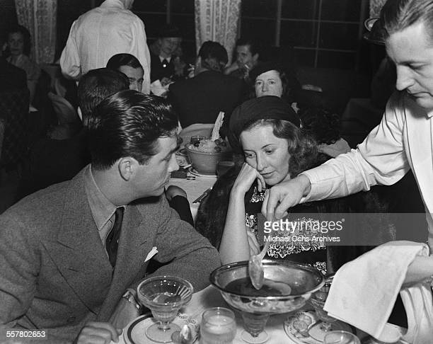 Actor Robert Taylor and his wife actress Barbara Stanwyck have dinner in Los Angeles California