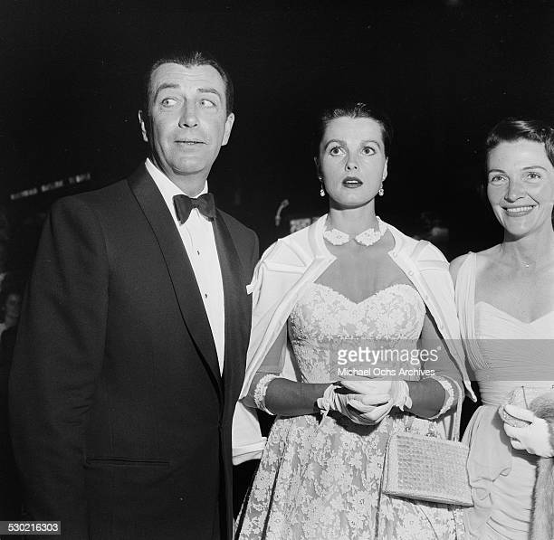 Actor Robert Taylor and wife Ursula Thiess and Nancy Reagan attend the premiere of King and I in Los AngelesCA